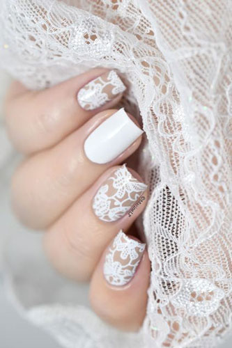 very delicate white nail design