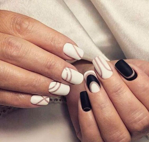a combination of white and black in manicure