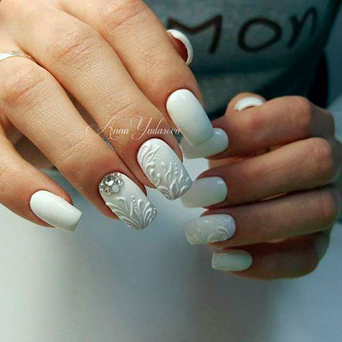 nail design in white tone to tone 2