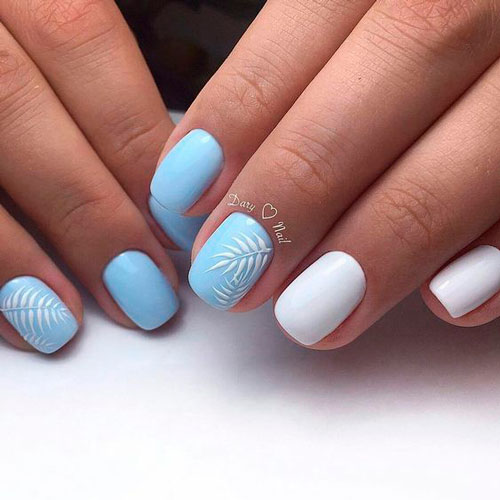 white with blue manicure