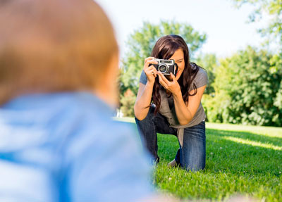 mother takes pictures on maternity leave