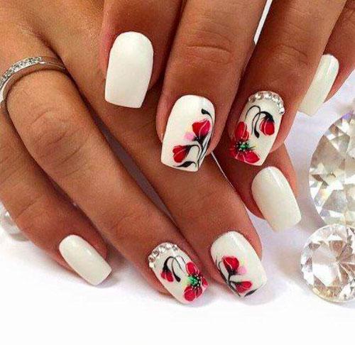 цветы на красных ногтях