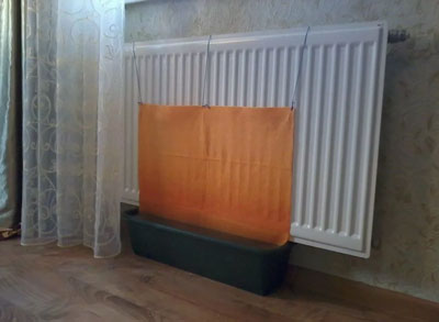 увлажнение воздуха в квартире с помощью мокрого полотенца