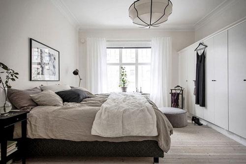 фото интерьера спальни в скандинавском стиле шкаф