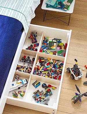 хранение детских игрушек под кроватью